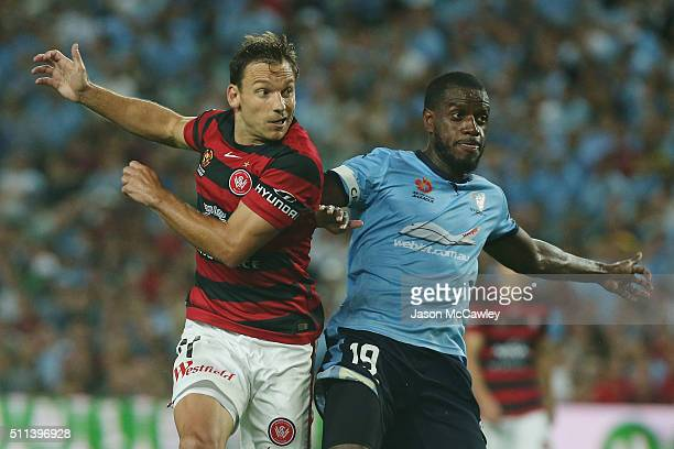 Brendon Santalab of the Wanderers is challenged by Jacques Faty of Sydneyduring the round 20 ALeague match between Sydney FC and the Western Sydney...