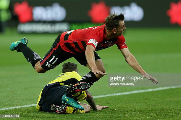 Brendon Santalab of the Wanderers is challenged by Storm Roux of the Mariners during the round four ALeague match between the Western Sydney...