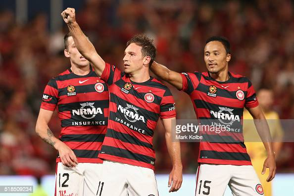 Brendon Santalab of the Wanderers is congratulated by Kearyn Baccus of the Wanderers as acknowledges the crowd while he celebrates scoring a goal...