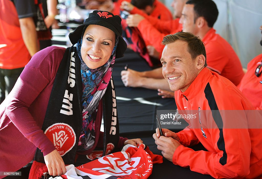 Brendon Santalab of the Wanderers poses for a photo with a fan during the A-League Grand Final Fan Day at Bonython Park on April 30, 2016 in Adelaide, Australia.
