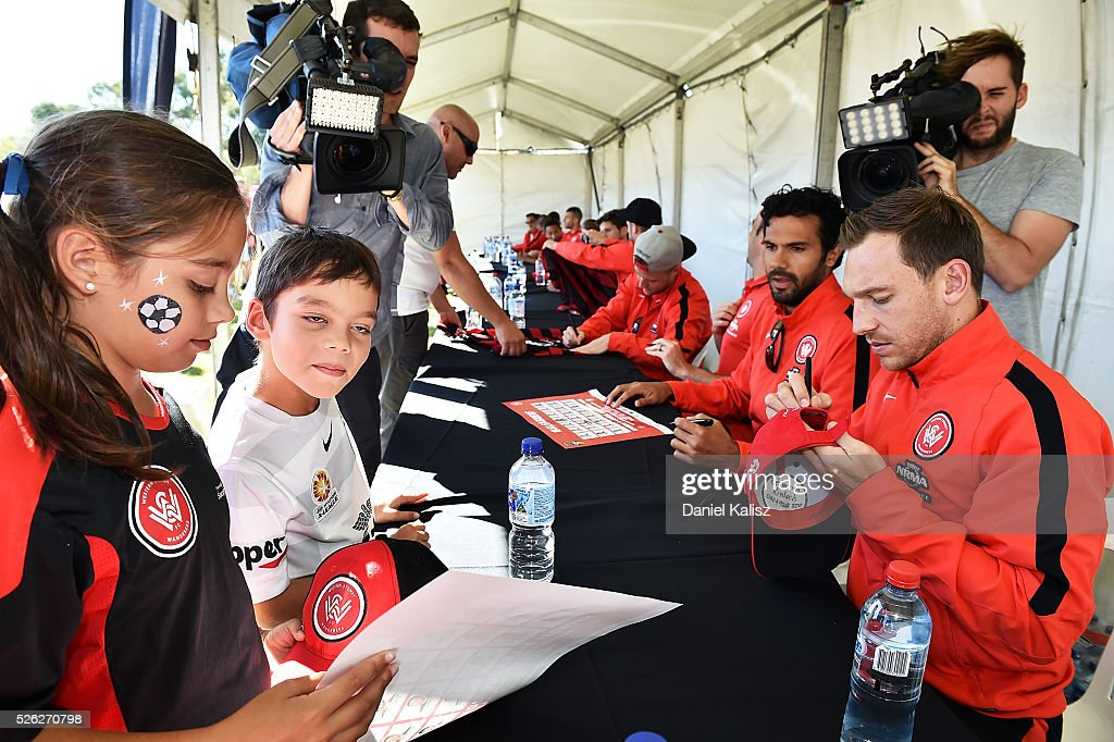 Brendon Santalab of the Wanderers signs an autograph for a fan during the A-League Grand Final Fan Day at Bonython Park on April 30, 2016 in Adelaide, Australia.