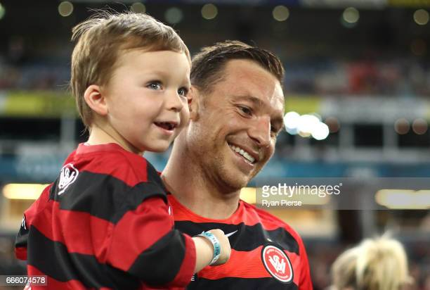 Brendon Santalab of the Wanderers walks out with his son during the round 26 ALeague match between the Western Sydney Wanderers and the Melbourne...