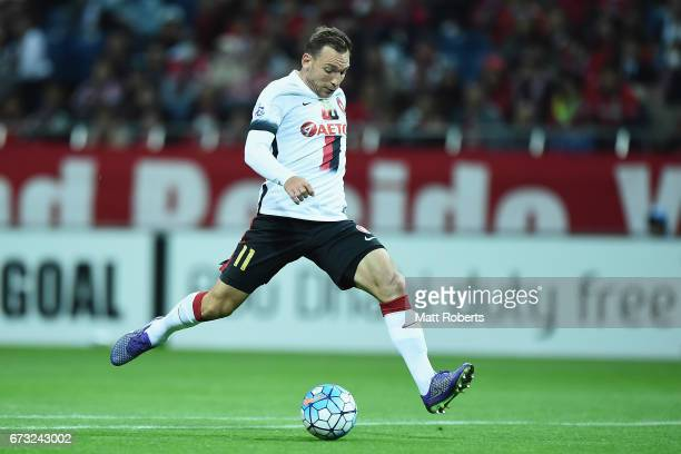 Brendon Santalab of Western Sydney Wanderers strikes the ball at goal during the AFC Champions League Group F match between Urawa Red Diamonds and...