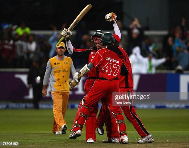 Brendon Taylor of Zimbabwe is mobbed by teammates after scoring the winning runs during the ICC Twenty20 World Championship match between Austalia...