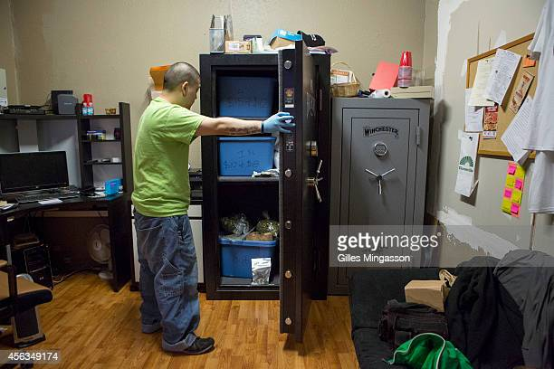 Brendon the manager of the cannabis store A Greener Today stores cannabis in safes in the store's backroom on March 14 2014 in Seattle Washington...