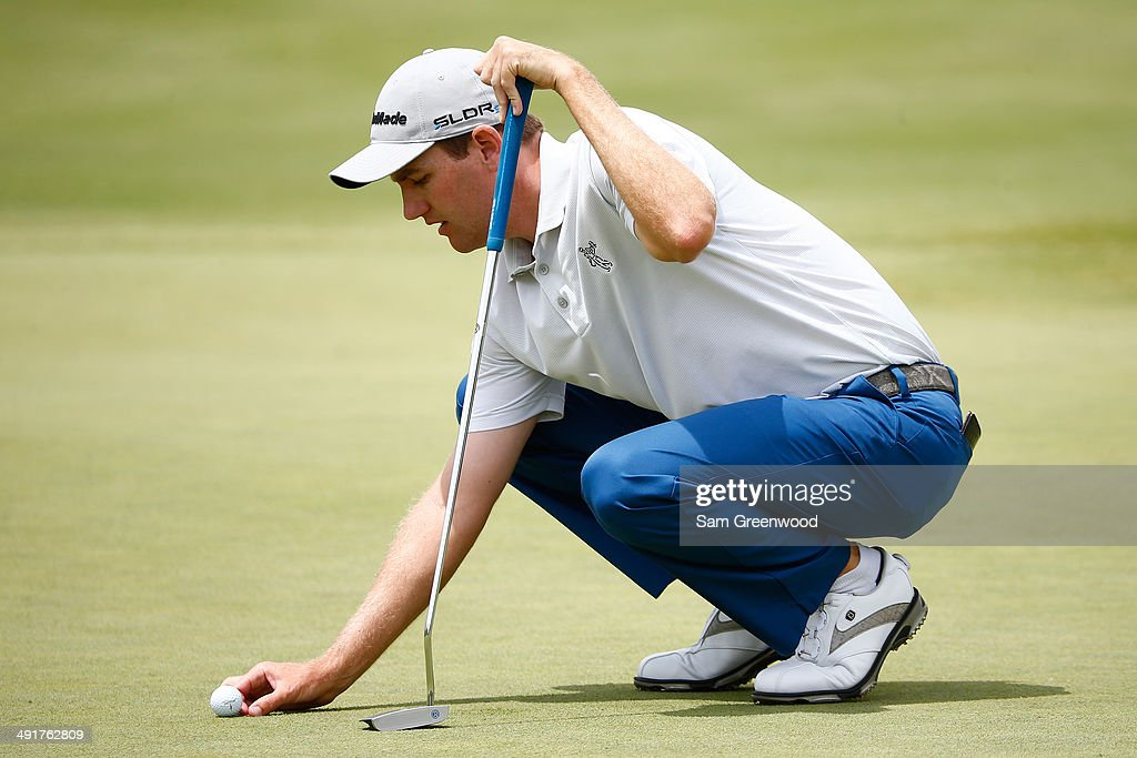 Brendon Todd Marks his ball on the green during the third round of the HP Byron Nelson Championship at the TPC Four Seasons on May 17 2014 in Irving...