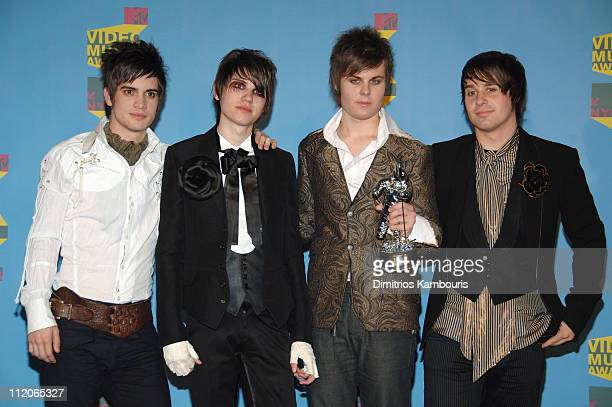 Brendon Urie Ryan Ross Spencer Smith and Jon Walker of Panic At the Disco winner Video of the Year for 'I Write Sins Not Tragedies'