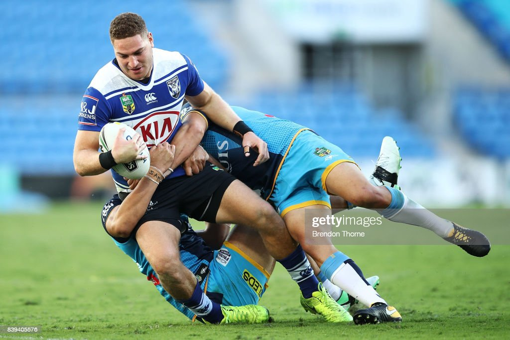 Brenko Lee of the Bulldogs is tackled by the Titans defence during the round 25 NRL match between the Gold Coast Titans and the Canterbury Bulldogs at Cbus Super Stadium on August 26, 2017 in Gold Coast, Australia.