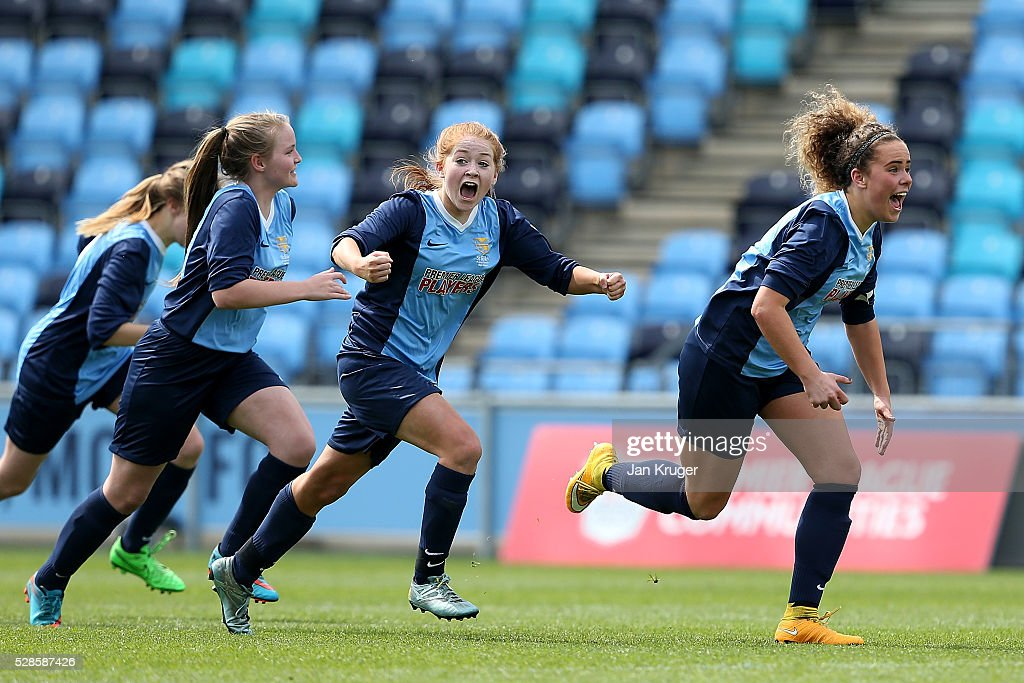 Brenna McPartlan(R) and Ebony Stinson of St Bede's School celebrates the win after a penalty shoot out during the Premier League U16 Schools Cup For Girls final between St Bede's School and Kings' School at the Etihad Campus on May 06, 2016 in Manchester, England.