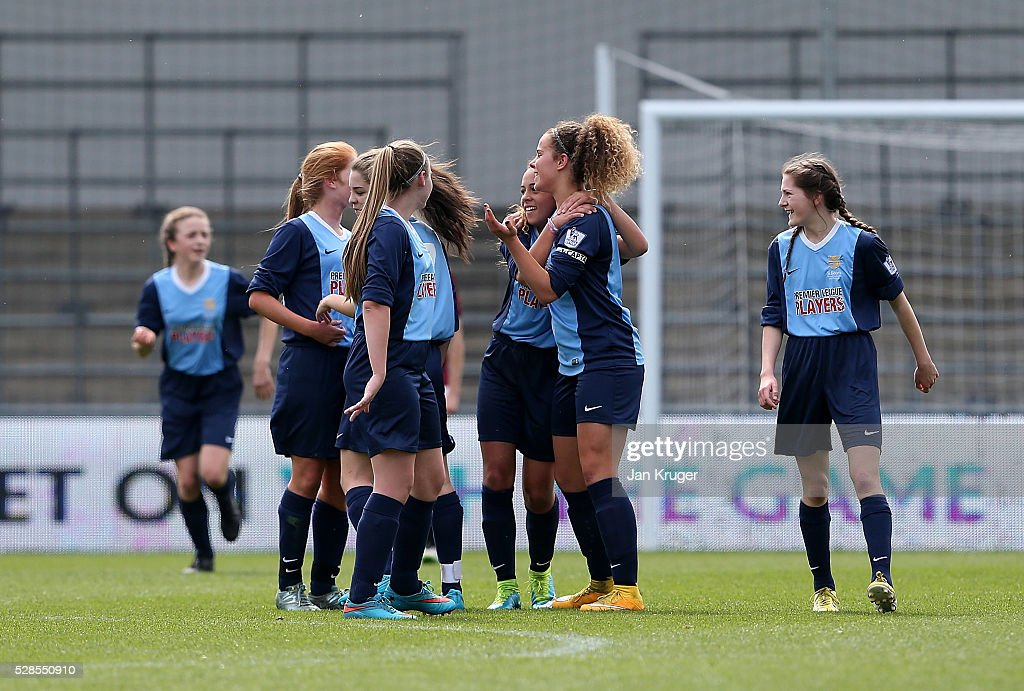Brenna McPartlan of St Bede's School celebrates her goal with team mates during the Premier League U16 Schools Cup For Girls final between St Bede's School and Kings' School at the Etihad Campus on May 06, 2016 in Manchester, England.