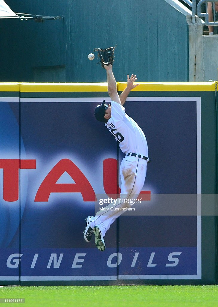 Brennan Boesch #26 of the Detroit Tigers attempts to make a leaping catch against the Kansas City Royals during the game at Comerica Park on April 10, 2011 in Detroit, Michigan. The Royals defeated the Tigers 9-5.