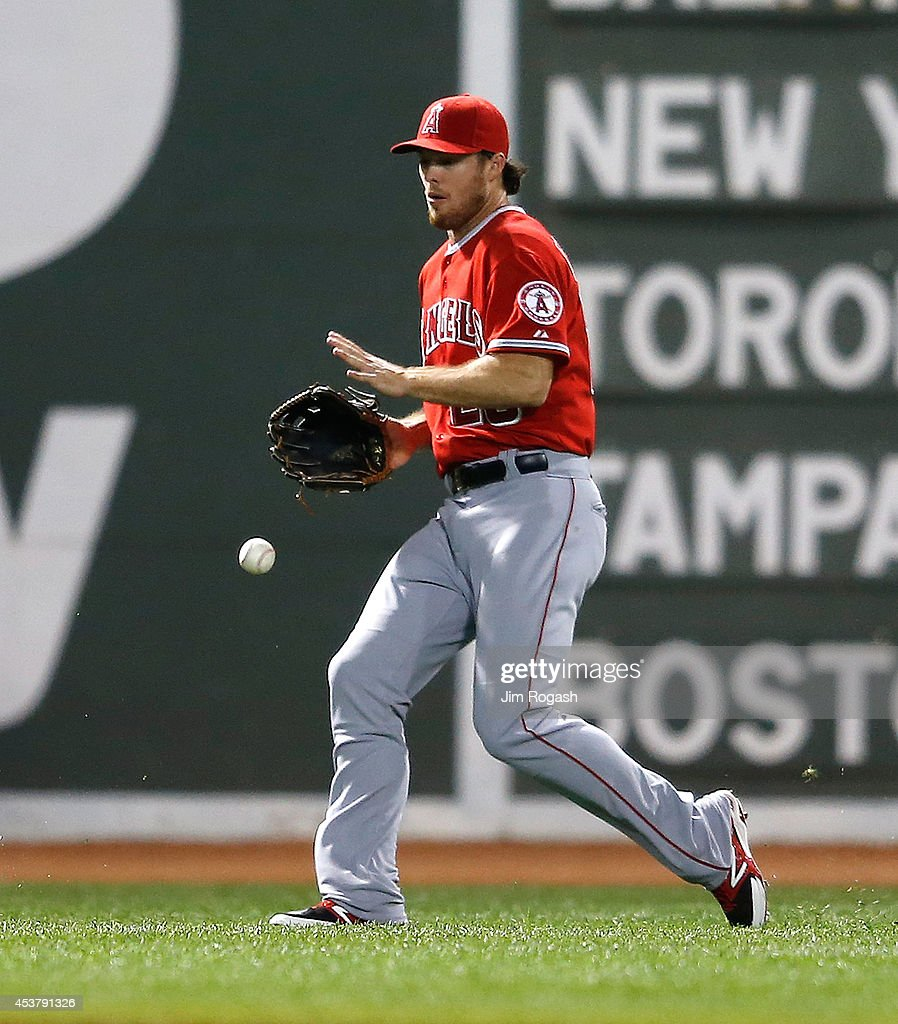 Brennan Boesch #28 of the Los Angeles Angels of Anaheim chases a ball off the bat of Brock Holt #26 of the Boston Red Sox that fell for an RBI single in the fourth inning against at Fenway Park on August 18, 2014 in Boston, Massachusetts.