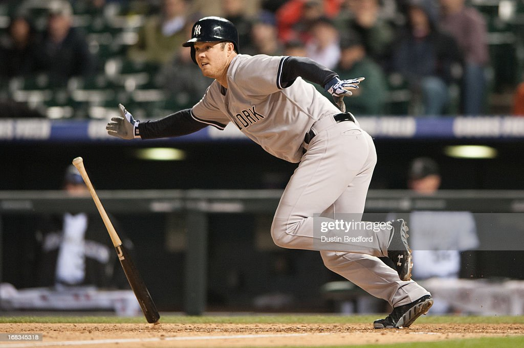 <a gi-track='captionPersonalityLinkClicked' href=/galleries/search?phrase=Brennan+Boesch&family=editorial&specificpeople=6754960 ng-click='$event.stopPropagation()'>Brennan Boesch</a> #22 of the New York Yankees hits a go-ahead RBI single in the top of the ninth inning at Coors Field on May 8, 2013 in Denver, Colorado. The Yankees beat the Rockies 3-2.