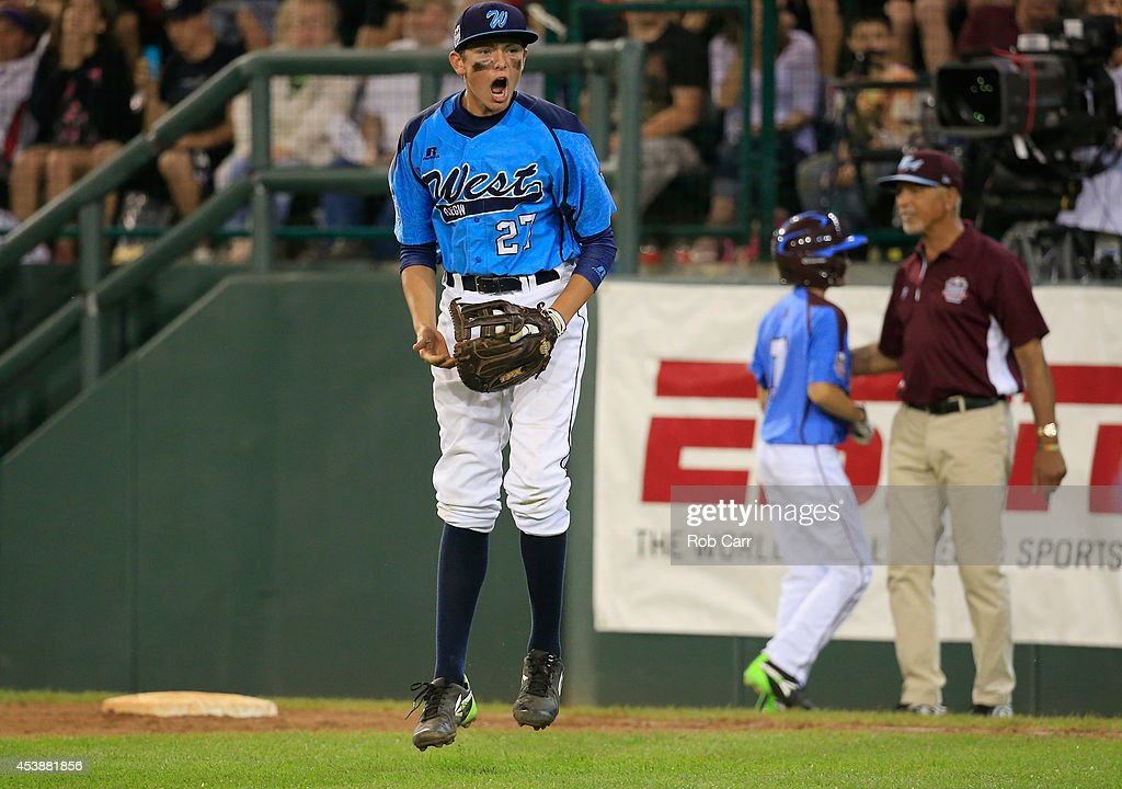 Brennan Holligan #27 of Nevada celebrates after forcing out a Pennsylvania batter for the third out of the fourth inning during the United States division game at the Little League World Series tournament at Lamade Stadium on August 20, 2014 in South Williamsport, Pennsylvania.