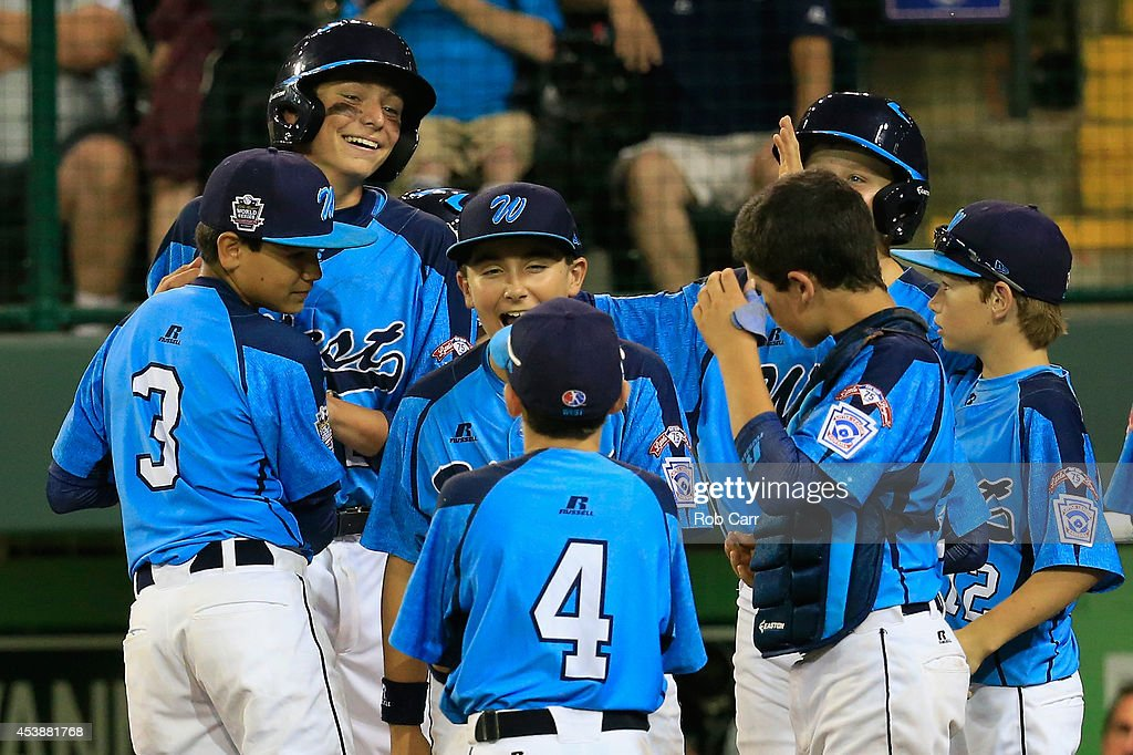 Brennan Holligan #27 (L) of Nevada celebrates after hitting a two RBI home run against Pennsylvania during the sixth inning of the United States division game at the Little League World Series tournament at Lamade Stadium on August 20, 2014 in South Williamsport, Pennsylvania.