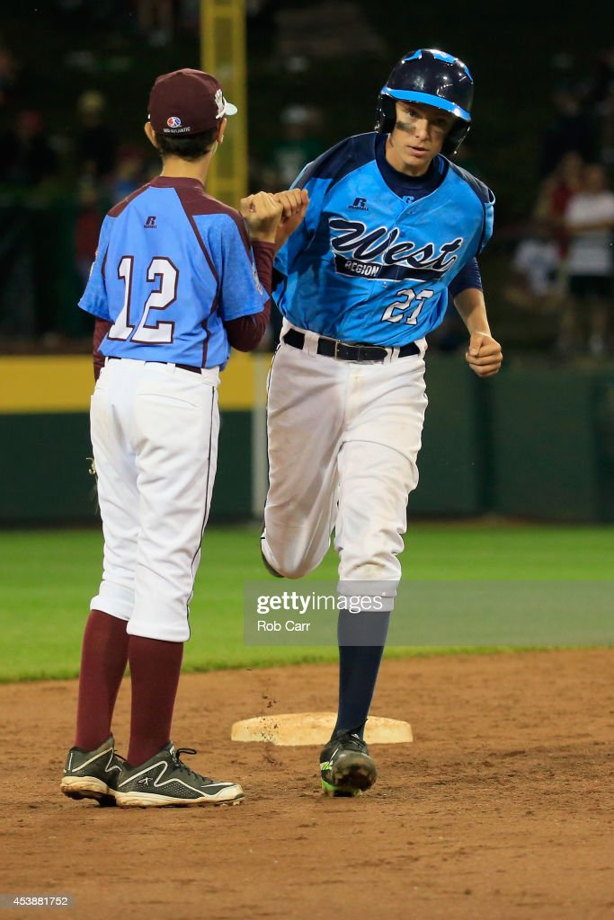 Brennan Holligan #27 of Nevada is congratulated by shortstop Jared Sprague-Lott of Pennsylvania after hitting a two RBI home run during the sixth inning of the United States division game at the Little League World Series tournament at Lamade Stadium on August 20, 2014 in South Williamsport, Pennsylvania.