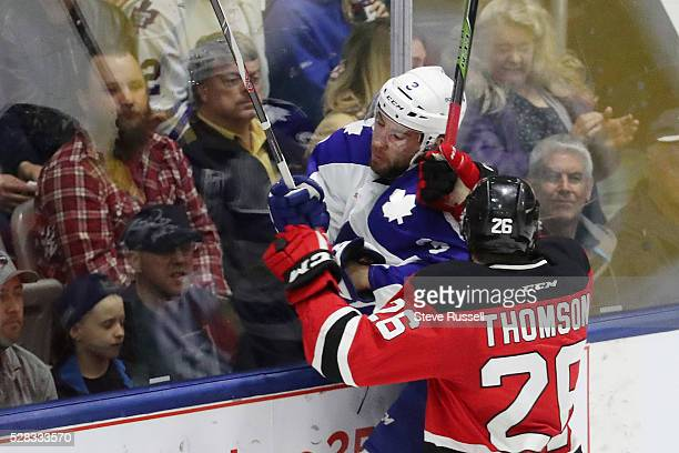 J Brennan is taken into the boards by Ben Thomson as the Toronto Marlies open up the second round of the American Hockey League playoffs against the...