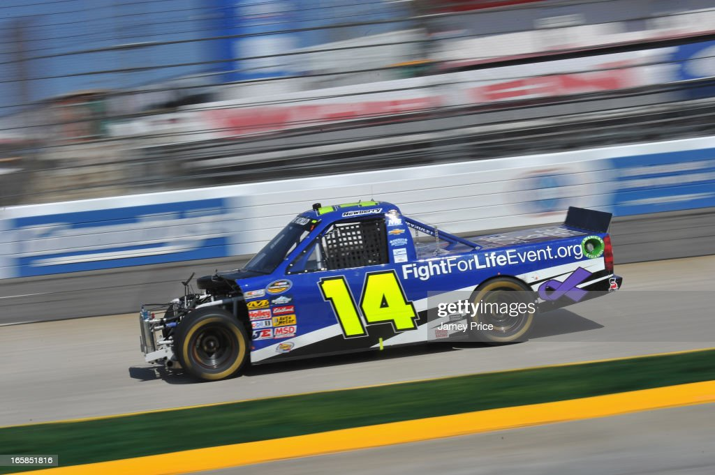 Brennan Newberry, driver of the #14 Fight For Life Chevrolet, drives his damaged truck during the NASCAR Camping World Truck Series Kroger 250 on April 6, 2013 at Martinsville Speedway in Ridgeway, Virginia.