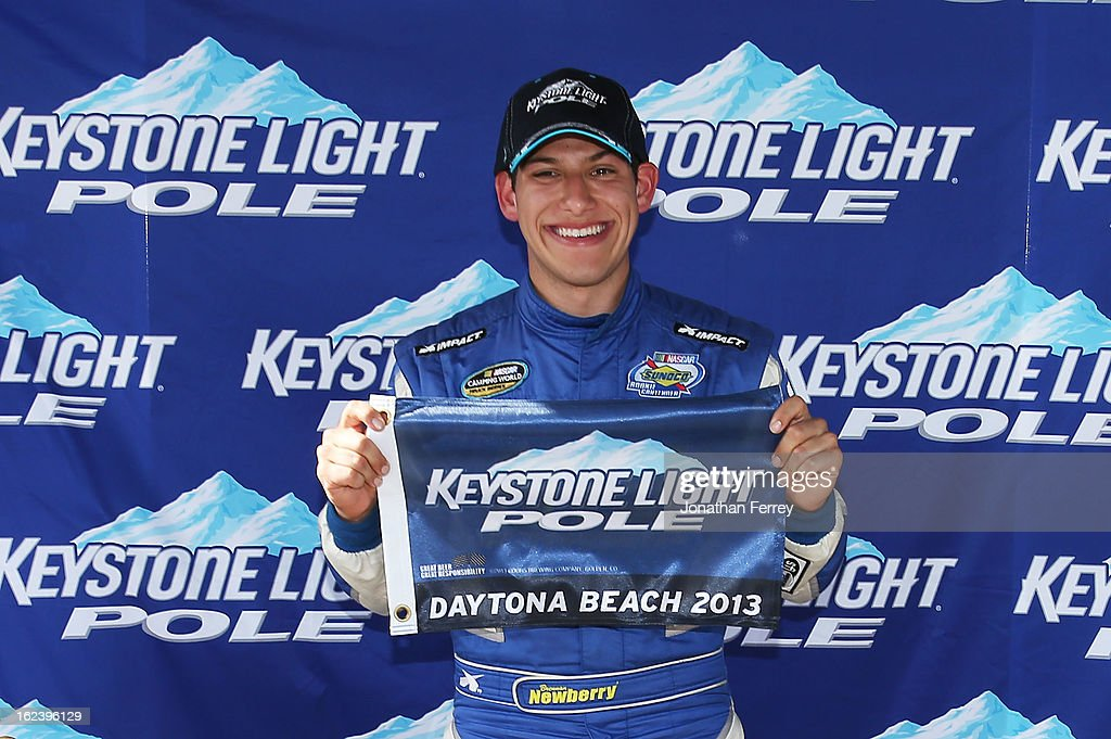Brennan Newberry, driver of the #14 Fight For Life Chevrolet, poses with the Keystone Light Pole position flag after qualifying first for the NASCAR Camping World Truck Series NextEra Energy Resources 250 at Daytona International Speedway on February 22, 2013 in Daytona Beach, Florida.