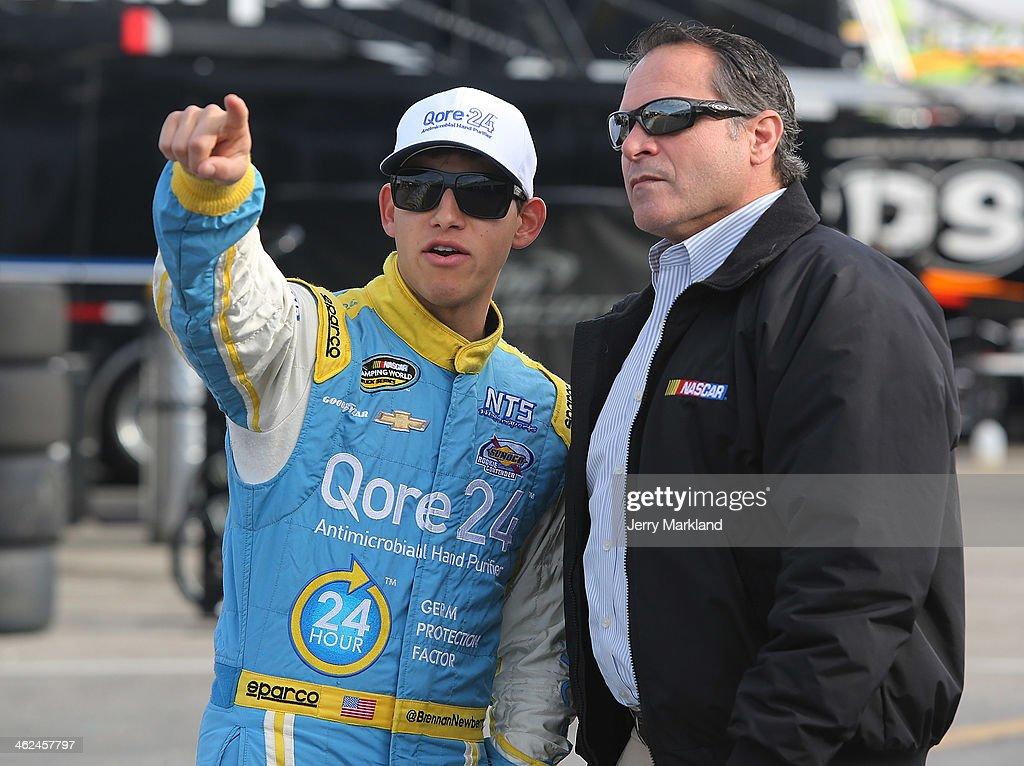 Brennan Newberry, driver of the #24 NTS Motorsports Chevrolet talks with Chad Little, NASCAR Camping World Series Managing Director during NASCAR Preseason Thunder at Daytona International Speedway on January 13, 2014 in Daytona Beach, Florida.