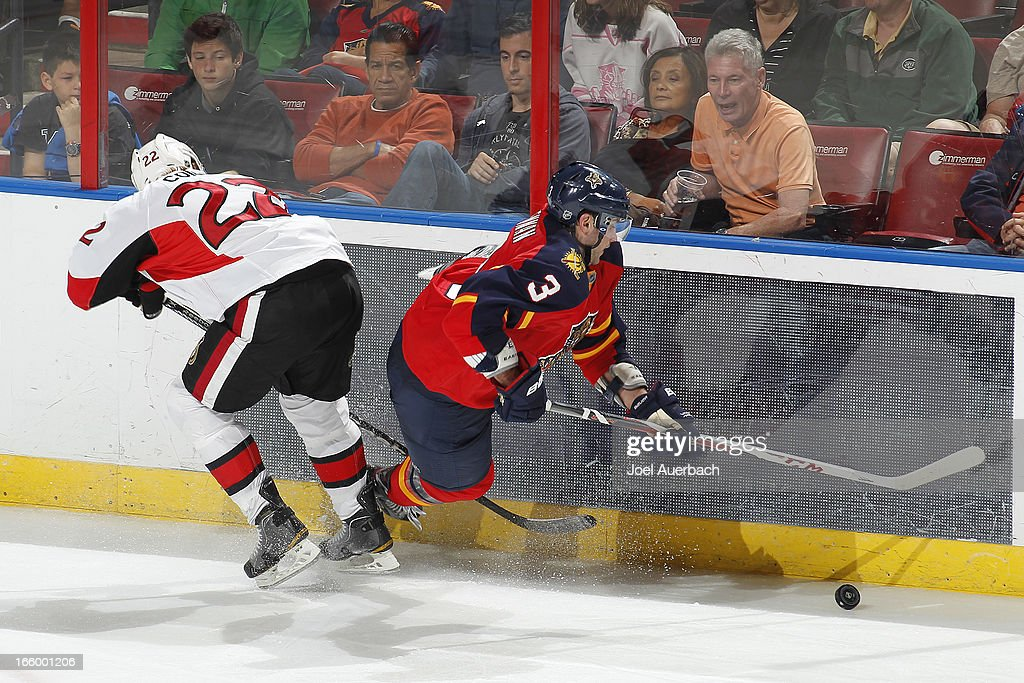 <a gi-track='captionPersonalityLinkClicked' href=/galleries/search?phrase=TJ+Brennan&family=editorial&specificpeople=7218748 ng-click='$event.stopPropagation()'>TJ Brennan</a> #3 of the Florida Panthers is checked off the puck by <a gi-track='captionPersonalityLinkClicked' href=/galleries/search?phrase=Erik+Condra&family=editorial&specificpeople=6254234 ng-click='$event.stopPropagation()'>Erik Condra</a> #22 of the Ottawa Senators during third period action at the BB&T Center on April 7, 2013 in Sunrise, Florida. The Panthers defeated the Senators 2-1.