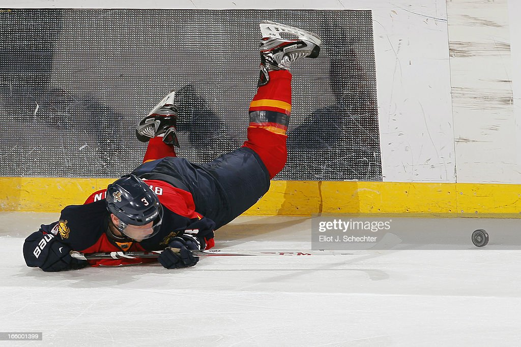 <a gi-track='captionPersonalityLinkClicked' href=/galleries/search?phrase=TJ+Brennan&family=editorial&specificpeople=7218748 ng-click='$event.stopPropagation()'>TJ Brennan</a> #3 of the Florida Panthers lies on the ice after colliding with Erik Condra #22 of the Ottawa Senators at the BB&T Center on April 7, 2013 in Sunrise, Florida.