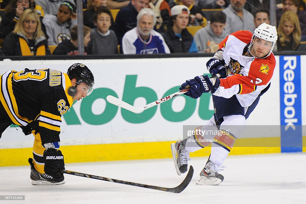 <a gi-track='captionPersonalityLinkClicked' href=/galleries/search?phrase=TJ+Brennan&family=editorial&specificpeople=7218748 ng-click='$event.stopPropagation()'>TJ Brennan</a> #3 of the Florida Panthers shoots the puck against <a gi-track='captionPersonalityLinkClicked' href=/galleries/search?phrase=Brad+Marchand&family=editorial&specificpeople=2282544 ng-click='$event.stopPropagation()'>Brad Marchand</a> #63 of the Boston Bruins at the TD Garden on April 21, 2013 in Boston, Massachusetts.
