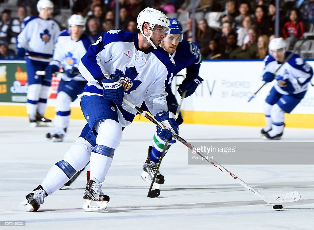 T.J. Brennan #3 of the Toronto Marlies controls the puck against the Utica Comets on January 24, 2016 at the Ricoh Coliseum in Toronto, Ontario, Canada.