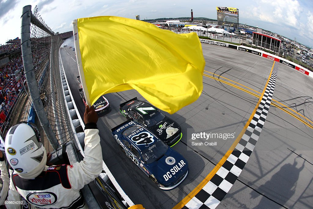 Brennan Poole, driver of the #48 DC Solar Chevrolet, and Justin Allgaier, driver of the #7 Breyers Chevrolet, cross the finish line under caution after the NASCAR XFINITY Series Sparks Energy 300 at Talladega Superspeedway on April 30, 2016 in Talladega, Alabama.