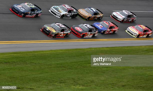 Brennan Poole driver of the DC Solar Chevrolet and Ty Dillon driver of the Bass Pro Shops/TRCKR BTS Chevrolet lead a pack of cars during the NASCAR...
