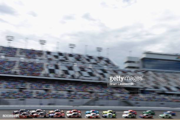 Brennan Poole driver of the DC Solar Chevrolet and Ty Dillon driver of the Bass Pro Shops/TRCKR BTS Chevrolet lead the field during the NASCAR...