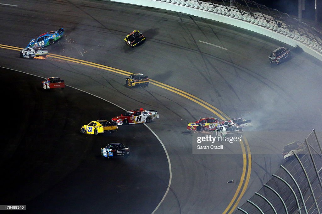 Brennan Poole, driver of the #42 DC Solar Chevrolet, <a gi-track='captionPersonalityLinkClicked' href=/galleries/search?phrase=Aric+Almirola&family=editorial&specificpeople=574878 ng-click='$event.stopPropagation()'>Aric Almirola</a>, driver of the #98 Fresh from Florida Ford, <a gi-track='captionPersonalityLinkClicked' href=/galleries/search?phrase=Blake+Koch&family=editorial&specificpeople=5683770 ng-click='$event.stopPropagation()'>Blake Koch</a>, driver of the #8 Celsius Healthy Energy Cola Toyota, <a gi-track='captionPersonalityLinkClicked' href=/galleries/search?phrase=Chris+Buescher&family=editorial&specificpeople=7728537 ng-click='$event.stopPropagation()'>Chris Buescher</a>, driver of the #60 Bit-O-Honey Ford, <a gi-track='captionPersonalityLinkClicked' href=/galleries/search?phrase=Dakoda+Armstrong&family=editorial&specificpeople=6624266 ng-click='$event.stopPropagation()'>Dakoda Armstrong</a>, driver of the #43 WinField Ford, and <a gi-track='captionPersonalityLinkClicked' href=/galleries/search?phrase=Regan+Smith&family=editorial&specificpeople=564271 ng-click='$event.stopPropagation()'>Regan Smith</a>, driver of the #7 Fire Alarm Services Chevrolet, are involved in an on-track incident during the NASCAR XFINITY Series Subway Firecracker 250 Powered By Coca-Cola at Daytona International Speedway on July 4, 2015 in Daytona Beach, Florida.