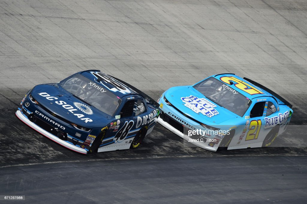 Brennan Poole, driver of the #48 DC Solar Chevrolet, drives in front of Daniel Hemric, driver of the #21 Blue Gate Bank Chevrolet, during practice for the NASCAR XFINITY Series Fitzgerald Glider Kits 300 at Bristol Motor Speedway on April 21, 2017 in Bristol, Tennessee.