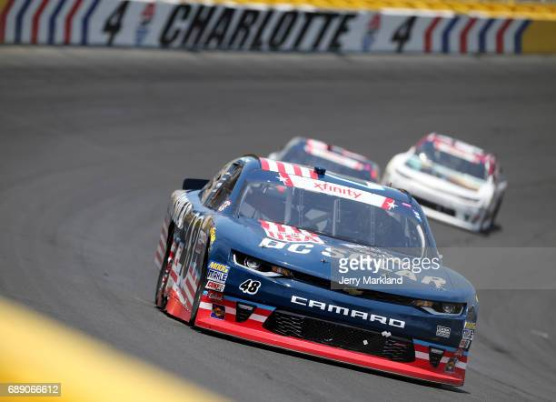 Brennan Poole driver of the DC Solar Chevrolet leads a pack of cars during the NASCAR Xfinity Series Hisense 4K TV 300 at Charlotte Motor Speedway on...