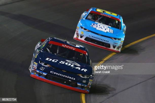 Brennan Poole driver of the DC Solar Chevrolet leads Spencer Gallagher Jr driver of the Allegiant Airlines Chevrolet during the NASCAR XFINITY Series...