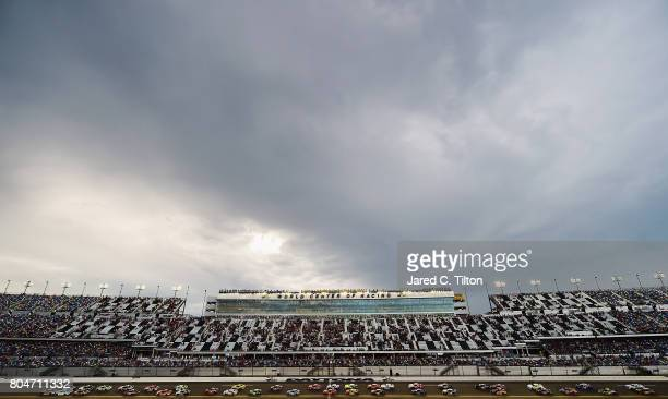 Brennan Poole driver of the DC Solar Chevrolet leads the field past the green flag to start the NASCAR XFINITY Series CocaCola Firecracker 250 at...
