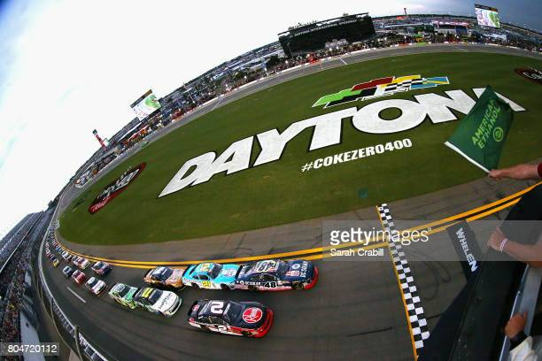 Brennan Poole driver of the DC Solar Chevrolet leads the field to the green flag to start the NASCAR XFINITY Series CocaCola Firecracker 250 at...