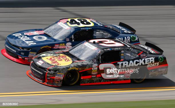 Brennan Poole driver of the DC Solar Chevrolet races Ty Dillon driver of the Bass Pro Shops/TRCKR BTS Chevrolet during the NASCAR XFINITY Series...