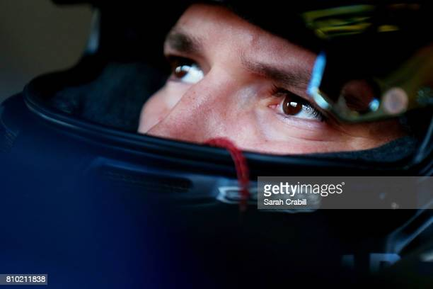 Brennan Poole driver of the DC Solar Chevrolet sits in his car during practice for the NASCAR XFINITY Series Alsco 300 at Kentucky Speedway on July 7...