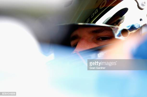 Brennan Poole driver of the DC Solar Chevrolet sits in his car during practice for the NASCAR XFINITY Series Zippo 200 at The Glen at Watkins Glen...