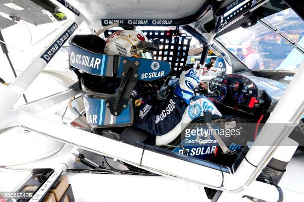 Brennan Poole driver of the DC Solar Chevrolet sits in his car during practice for the NASCAR Xfinity Series Food City 300 at Bristol Motor Speedway...