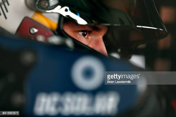 Brennan Poole driver of the DC Solar Chevrolet sits in his car during practice for the NASCAR XFINITY Series Sports Clips Haircuts VFW 200 at...