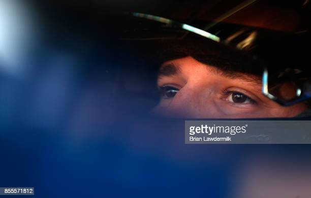 Brennan Poole driver of the DC Solar Chevrolet sits in his car during practice for the NASCAR XFINITY Series 'Use Your Melon Drive Sober 200' at...