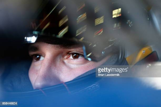 Brennan Poole driver of the DC Solar Chevrolet sits in his car during practice for the NASCAR XFINITY Series Drive for the Cure 300 presented by Blue...