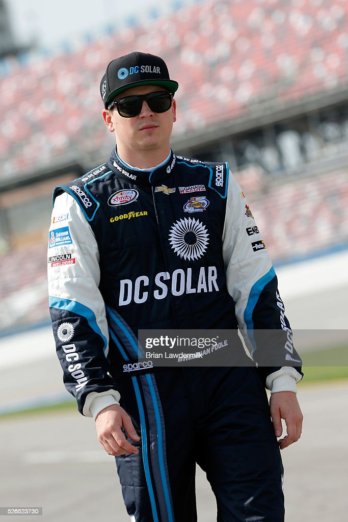 Brennan Poole, driver of the #48 DC Solar Chevrolet, stands on the grid during qualifying for the NASCAR XFINITY Series Sparks Energy 300 at Talladega Superspeedway on April 30, 2016 in Talladega, Alabama.