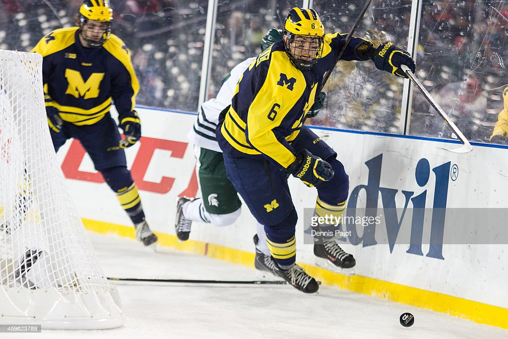 Brennan Serville #6 drives for th puck against the Michigan Wolverines of the Michigan State Spartans on December 28, 2013 at Comerica Park in Detroit, Michigan.