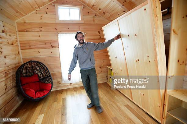 Brent Adler opens up a murphy bed in one of his tiny houses on Chapel St in Portland Tuesday October 25 2016 Adler says he has tenants ready to move...