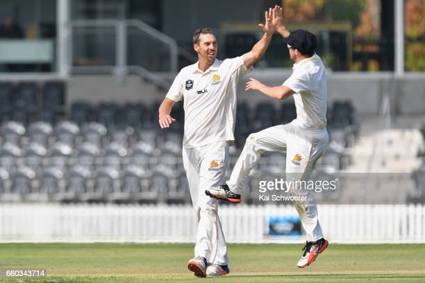Brent Arnel of Wellington is congratulated by team mates after dismissing Will Williams of Canterbury during the Plunket Shield match between...