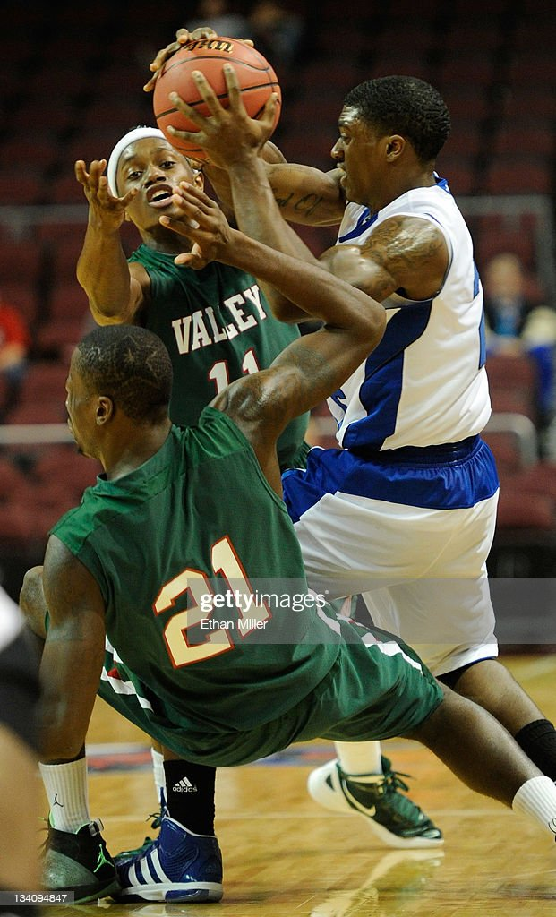 Brent Arrington #11 and Cor-J Cox #21 of the Mississippi Valley State Delta Devils defend against Patrick Miller #2 of the Tennessee State Tigers during the third round of the Continental Tire Las Vegas Invitational at the Orleans Arena November 25, 2011 in Las Vegas, Nevada.