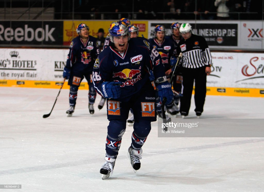 Brent Aubin of EHC Red Bull Muenchen celebrates scoring during the DEL match between EHC Red Bull Muenchen and Thomas Sabo Ice Tigers at Olympia Eishalle on March 1, 2013 in Munich, Germany.